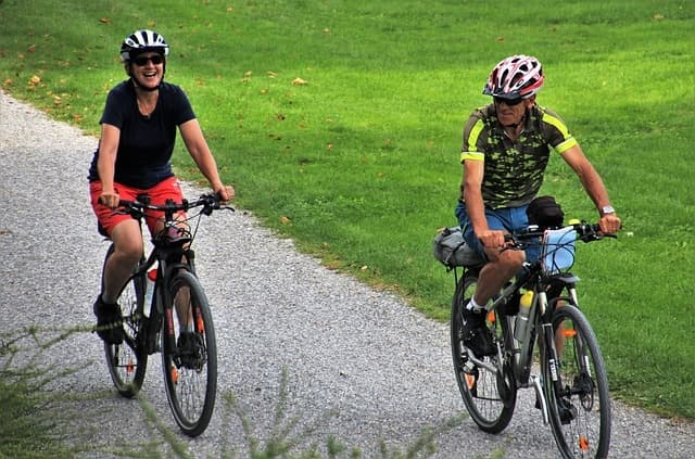 Woman and man cycling
