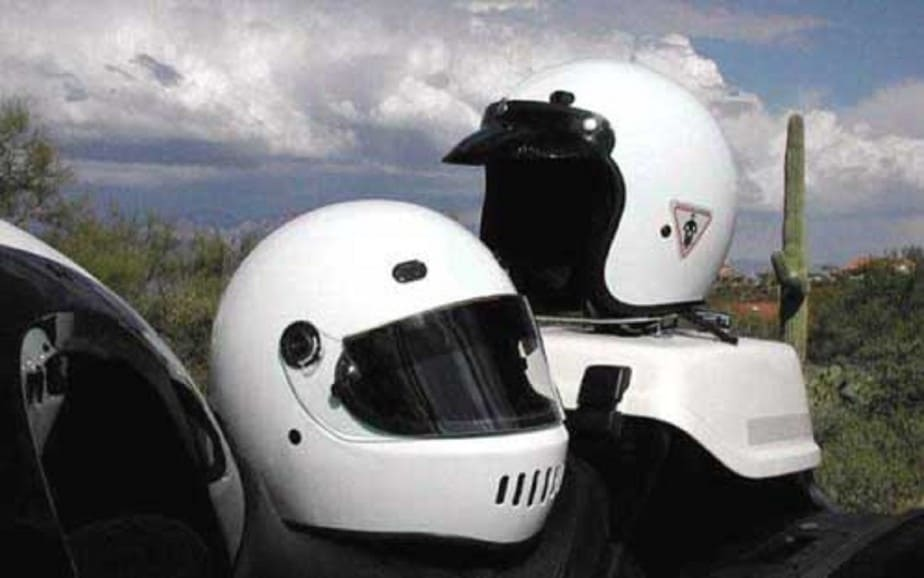 Two white motorcycle helmets