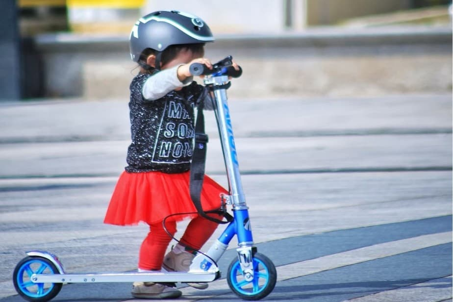 Toddler riding kick scooter